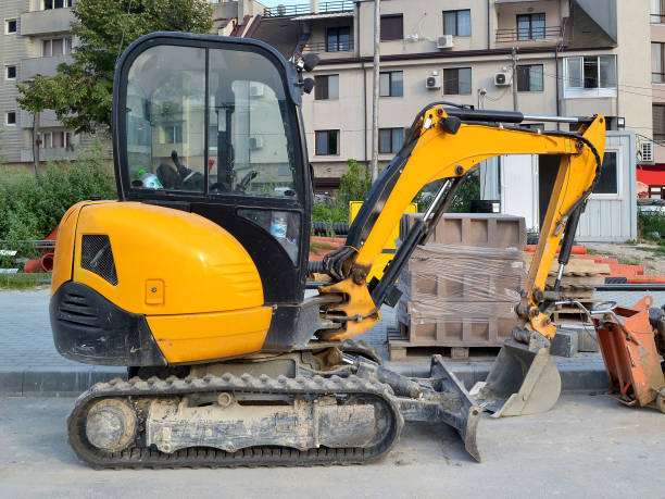 Best Mini Excavator Stock Photos, Pictures & Royalty-Free Images