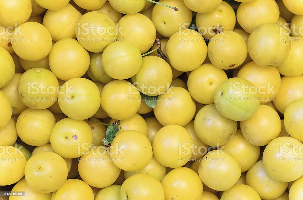 yellow mirabelle plums, background, texture stock photo
