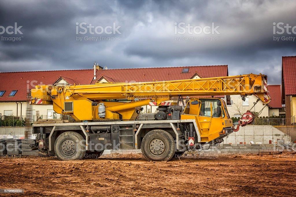 Yellow mobile crane in construction site stock photo