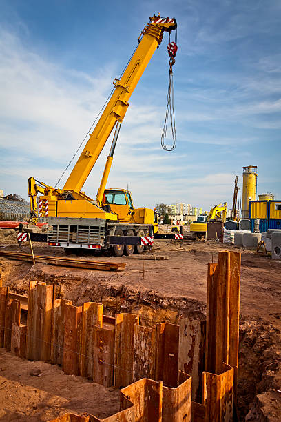 Yellow mobile crane in road construction Yellow mobile crane in road construction mobile crane stock pictures, royalty-free photos & images