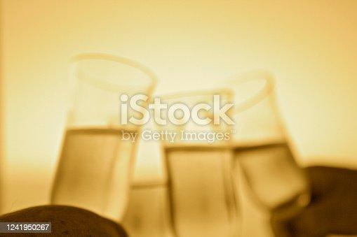1144550840 istock photo Yellow monochrome Champagne Toast 1241950267