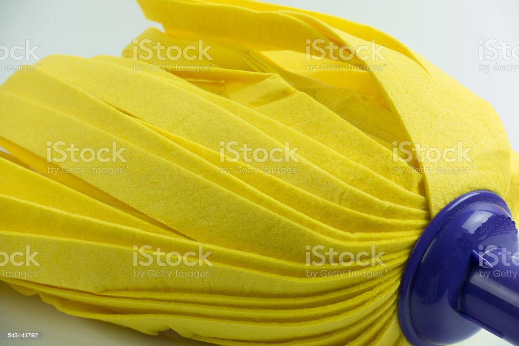 Yellow mop on white background. stock photo