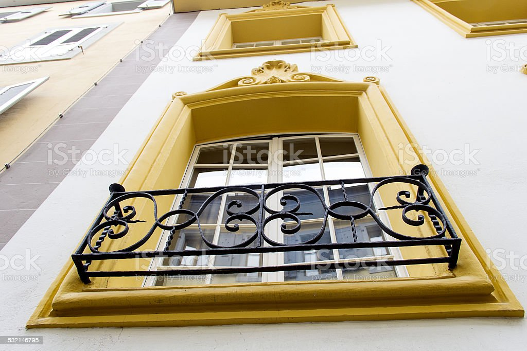 Yellow morning window with french balcony stock photo