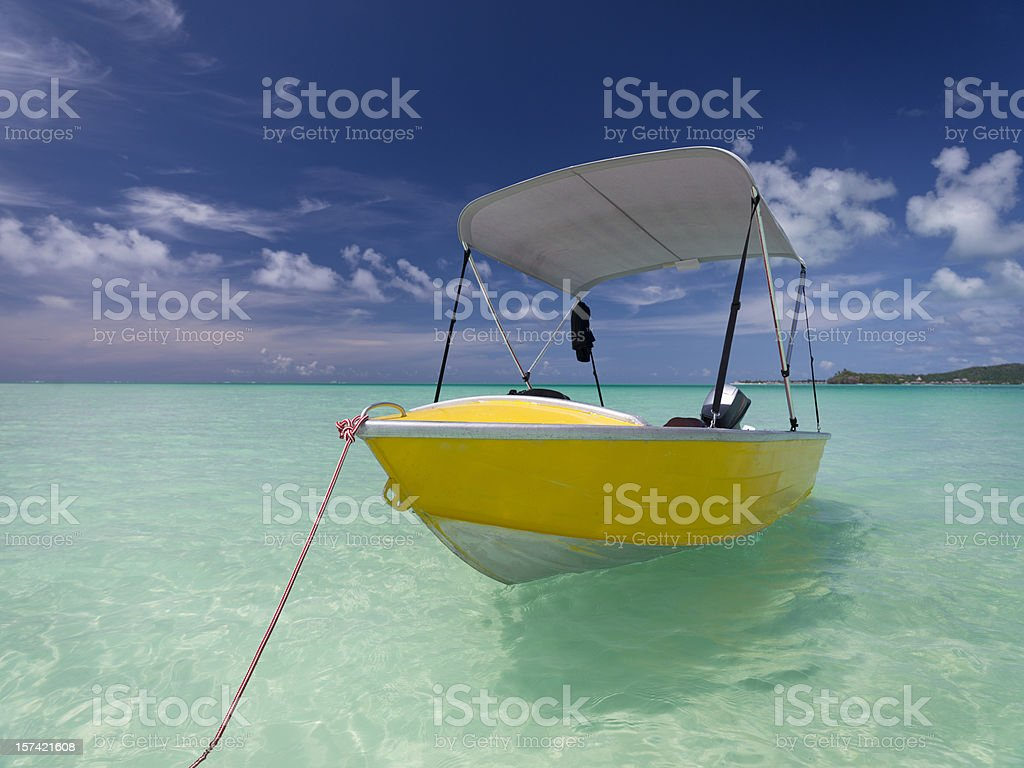 Yellow Motor Boat in Turquoise Lagoon royalty-free stock photo