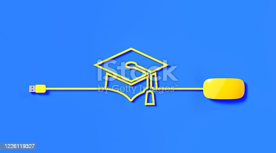 Yellow mouse cable forming graduation cap icon on blue background. Horizontal composition with copy space. Online education concept.