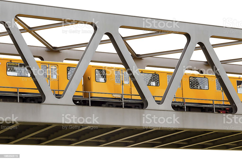 yellow moving train on an iron bridge royalty-free stock photo