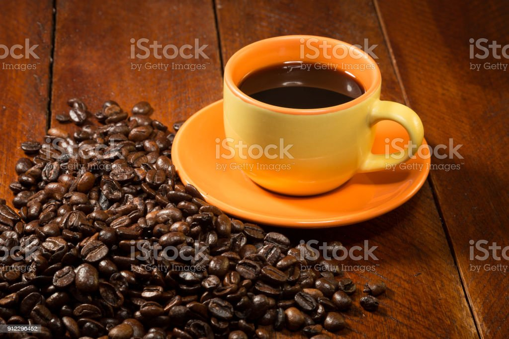 With Coffee By Yellow Beans Stock Photo Filled Surrounded Mug fvb7gyY6