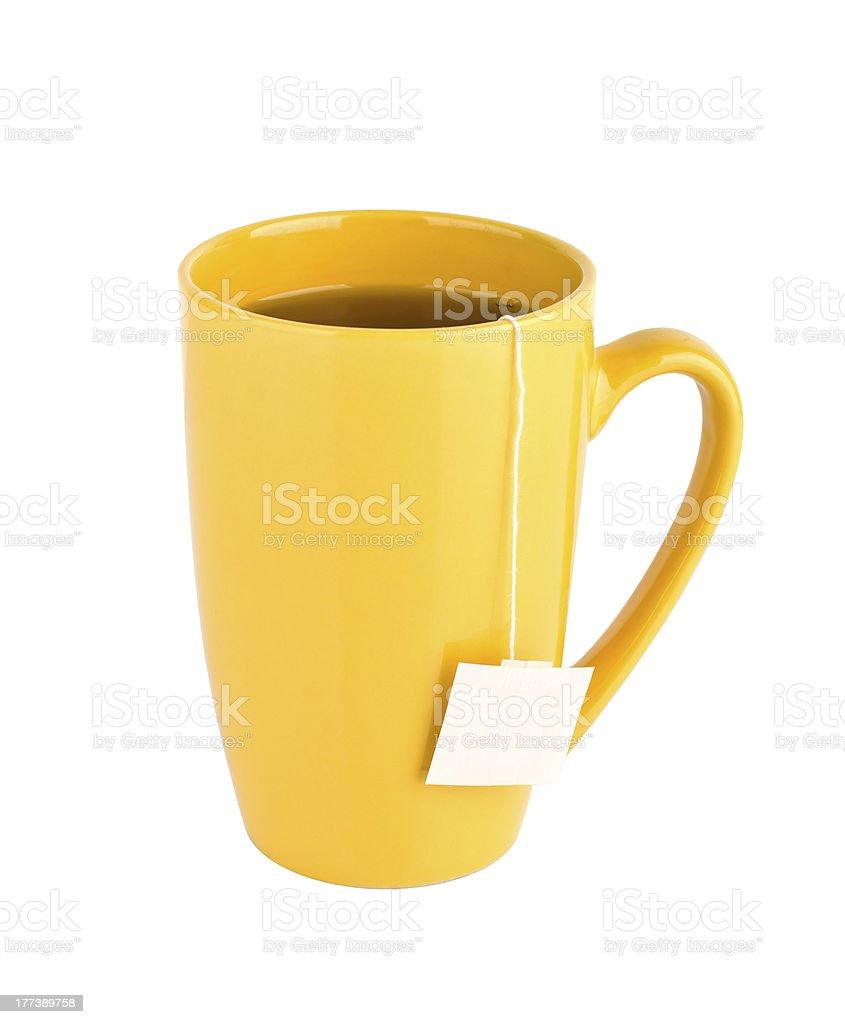 Yellow mug of tea isolated on white background royalty-free stock photo