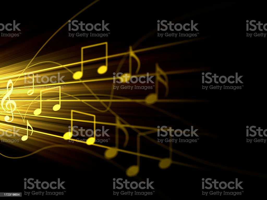 Yellow music notes on a staff with a black background stock photo