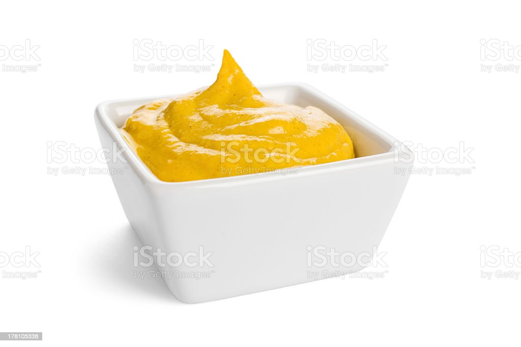 Yellow mustard in a square white dish stock photo