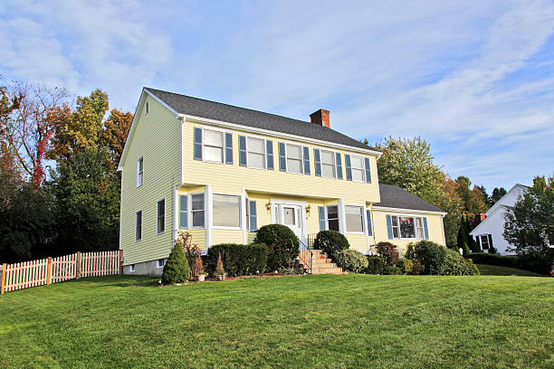 Yellow New England Style colonial house  colonial style stock pictures, royalty-free photos & images