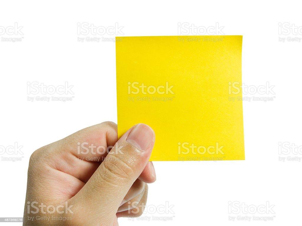 Yellow note in man hand stock photo