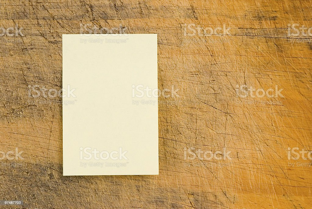 Yellow note paper on retro wood royalty-free stock photo
