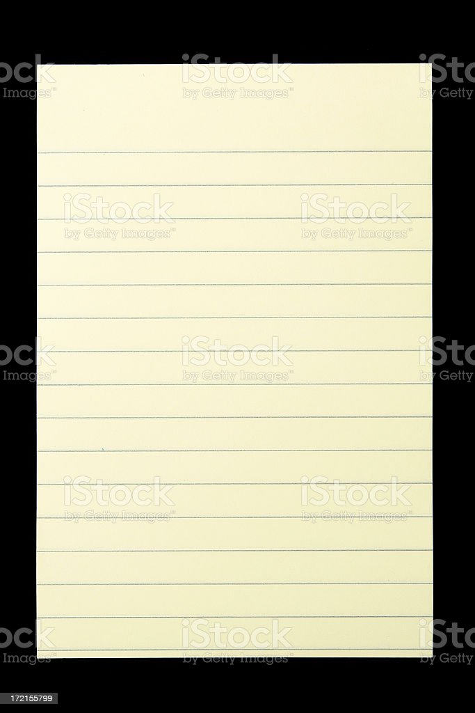 Yellow notepad isolated on black royalty-free stock photo