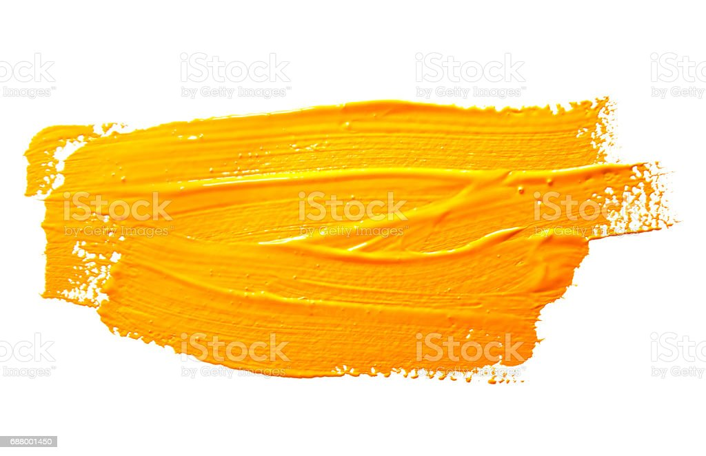 Yellow ochre strokes of the paint brush isolated stock photo