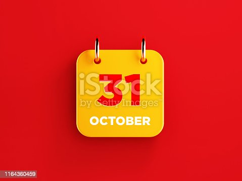 istock Yellow October 31 Calendar on Red Background 1164360459