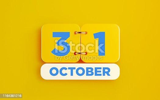 istock Yellow October 31 Calendar on Yellow Background 1164361216