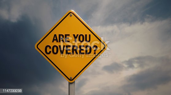 Yellow off road traffic sign with are you covered text on cloudy sky. Horizontal composition with copy space.