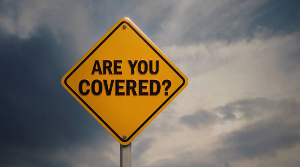 Yellow Off Road Traffic Sign With Are You Covered Text on Cloudy Sky stock photo