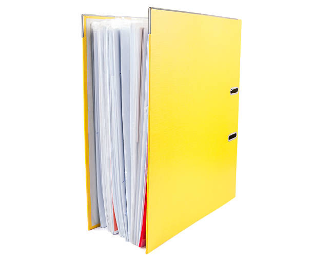 yellow office folder full of papers on white background - full stock photos and pictures