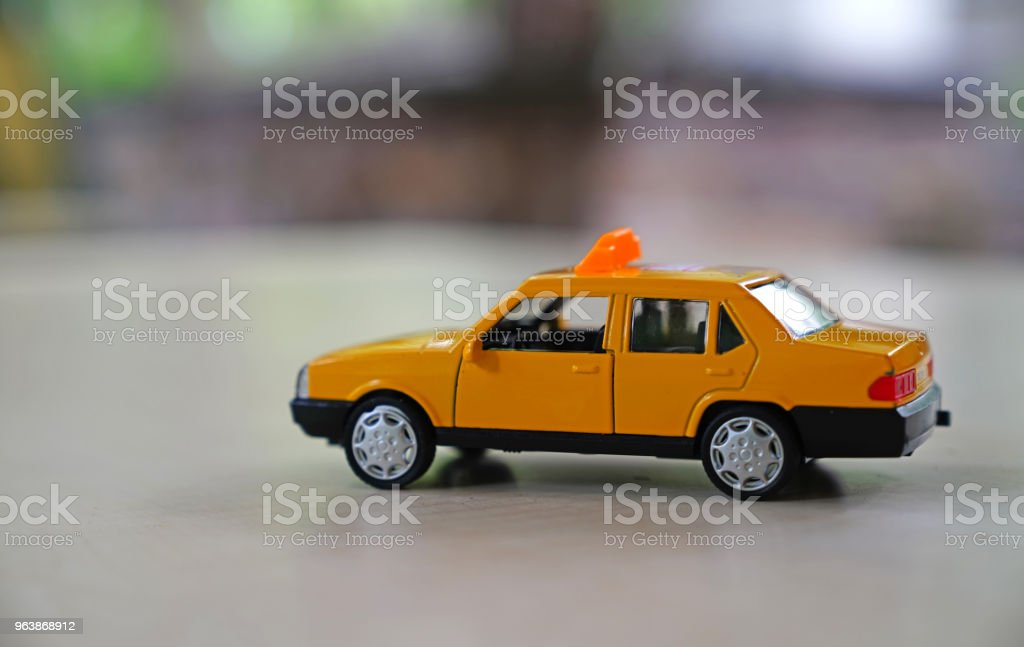 Yellow old taxi car on road on blurred background - Royalty-free Bridge - Built Structure Stock Photo