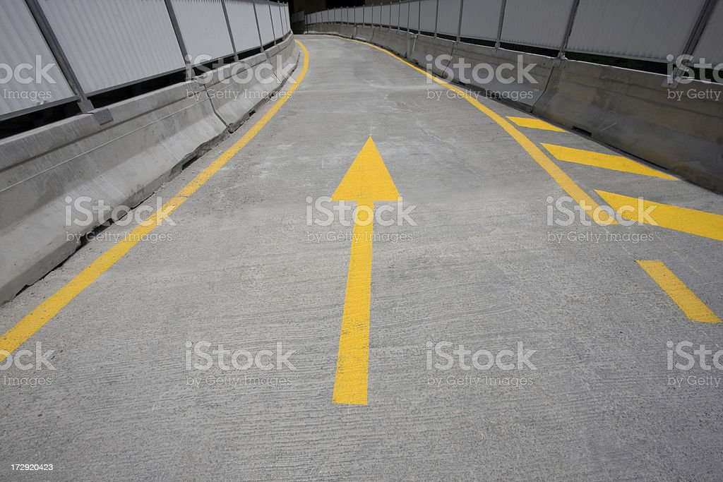 Yellow one way arrow on a concrete road construction royalty-free stock photo