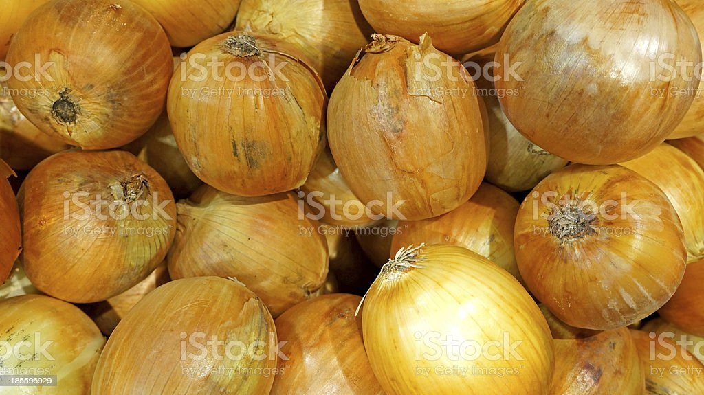 Yellow onions crop. Close up royalty-free stock photo
