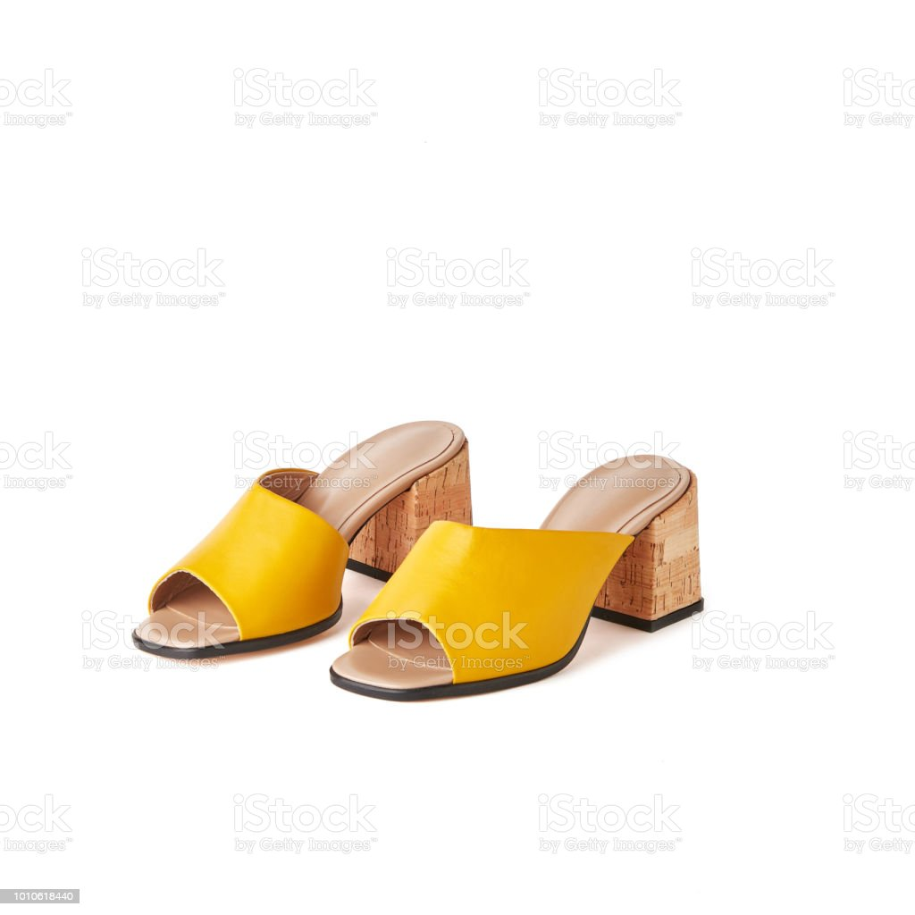 db00edfdf Yellow open toe block heel mules shoes. Studio shot, white background  royalty-free