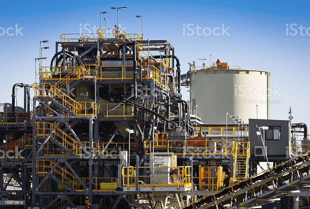 A yellow or grey processing plant stock photo