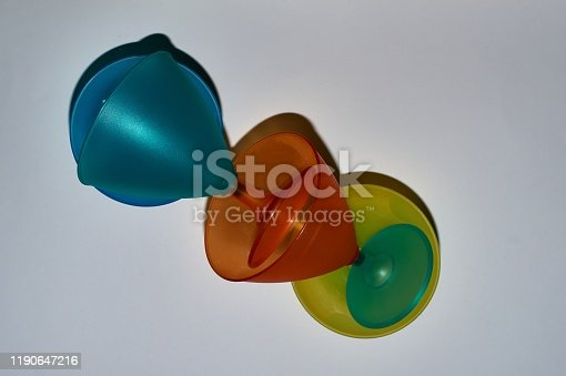istock yellow, orange, blue, turquoise mug from top to bottom, top-down photographed 1190647216