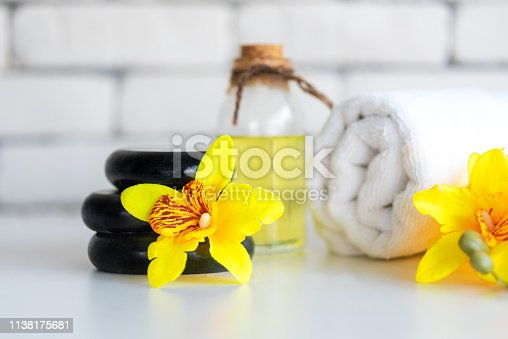 istock Yellow orchid aromatherapy Spa with candle. Thai Spa relax Treatments and massage white background. Healthy Concept. 1138175681