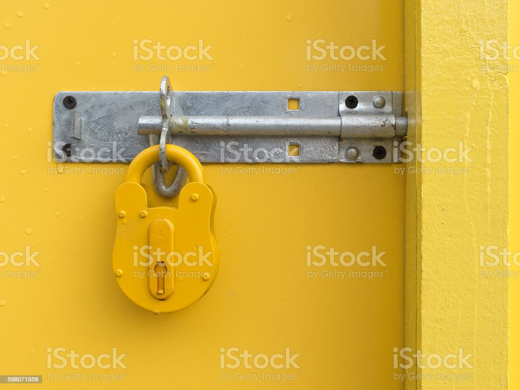 Yellow Padlock on Yellow Door stock photo