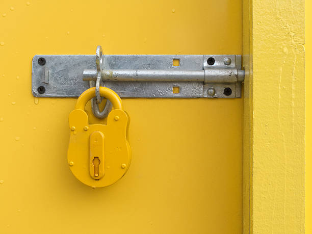 Yellow Padlock on Yellow Door stock photo
