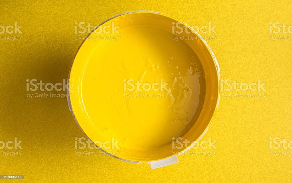 Yellow paint box on yellow background stock photo