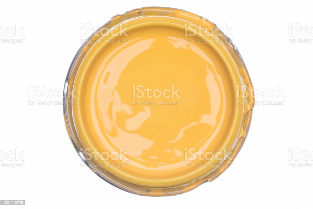 Yellow paint can lid isolated on white background royalty-free stock photo