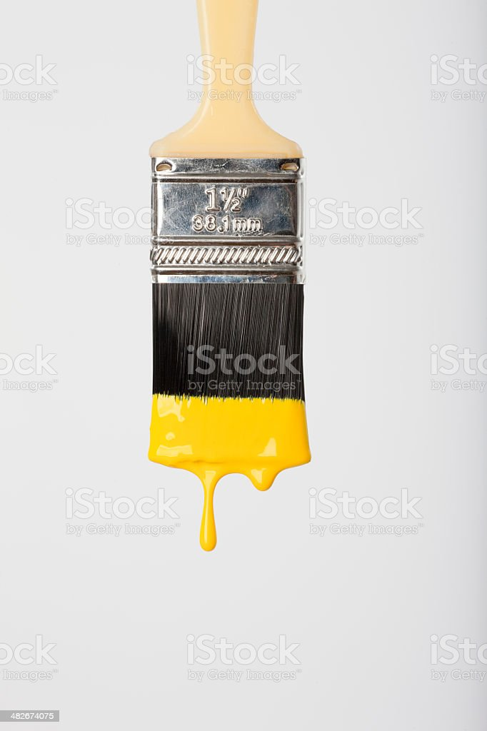 Yellow Paint dripping from Brush royalty-free stock photo