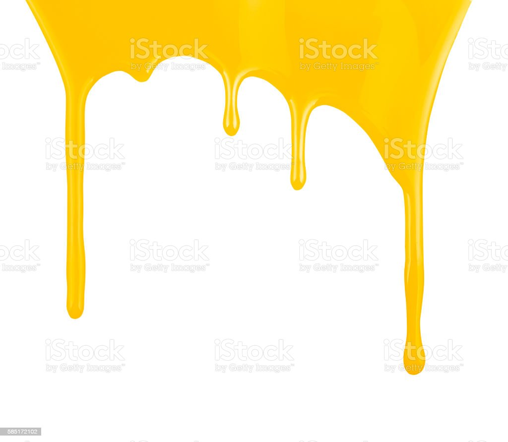 Yellow paint dripping isolated on white background stock photo