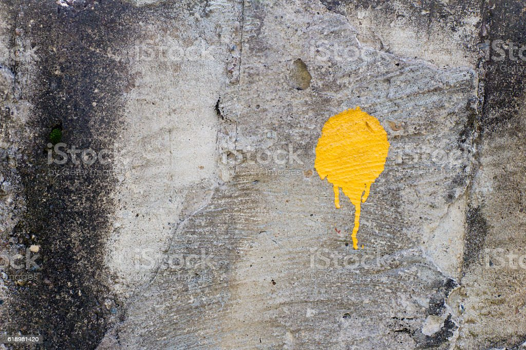 Yellow paint stain on old and dirty wall. The surface stock photo