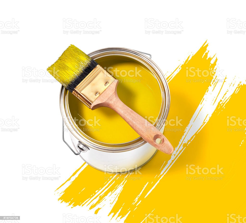 Yellow paint tin can with brush on top stock photo