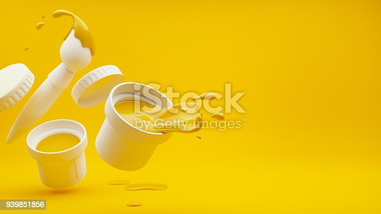 939851856 istock photo Yellow paint with splashes and art brush 939851856