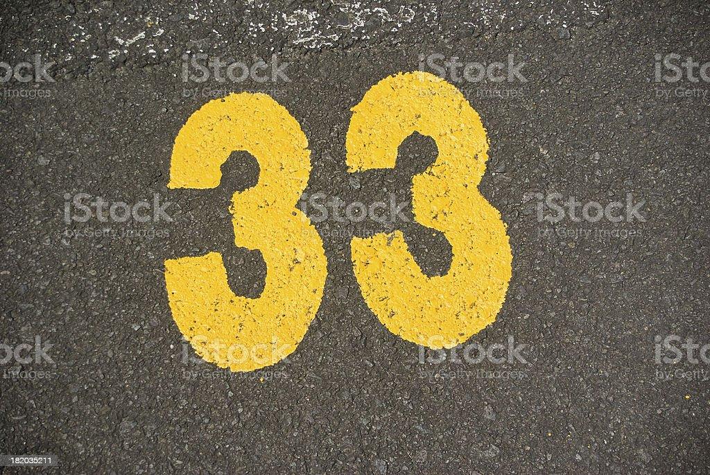 yellow painted number thirty three '33' stock photo
