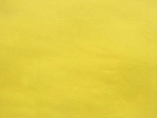 yellow painted wall background - solido foto e immagini stock