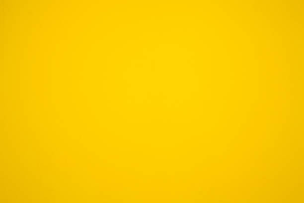 yellow painted wall, yellow color backgrounds - yellow stock photos and pictures