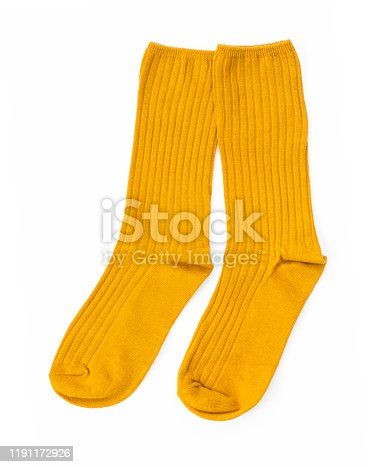 Yellow pair of socks isolated on a white background, Top view