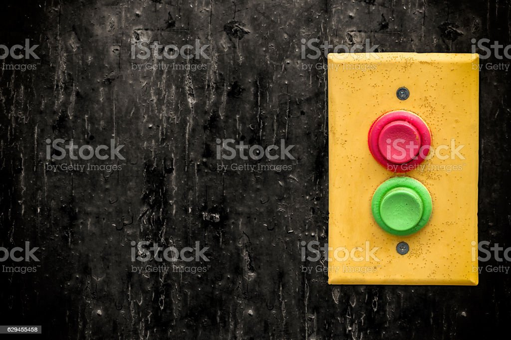 Yellow panel with rempty red and green buttons stock photo