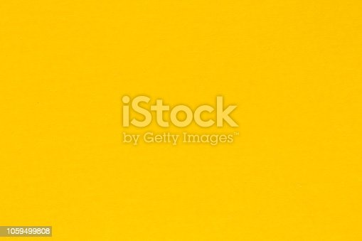 924754302 istock photo Yellow paper background, colorful paper texture. High resolution photo 1059499808