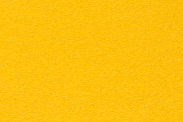 yellow paper background, colorful paper texture - yellow stock photos and pictures