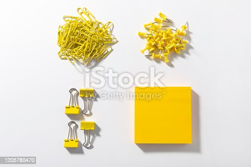 Office Supplies on white backgroundsYellow paper clips on white background