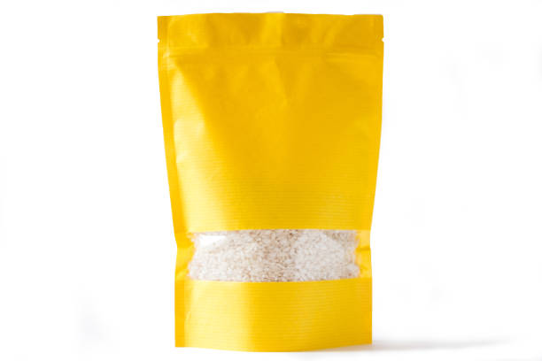 yellow paper doypack stand up bio pouch with window  zipper on white background filled with rice stock photo