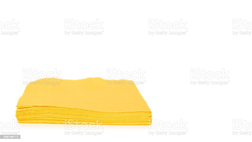 Yellow paper napkin for food isolated on white background. Kitchen serving object. copy space, template stock photo